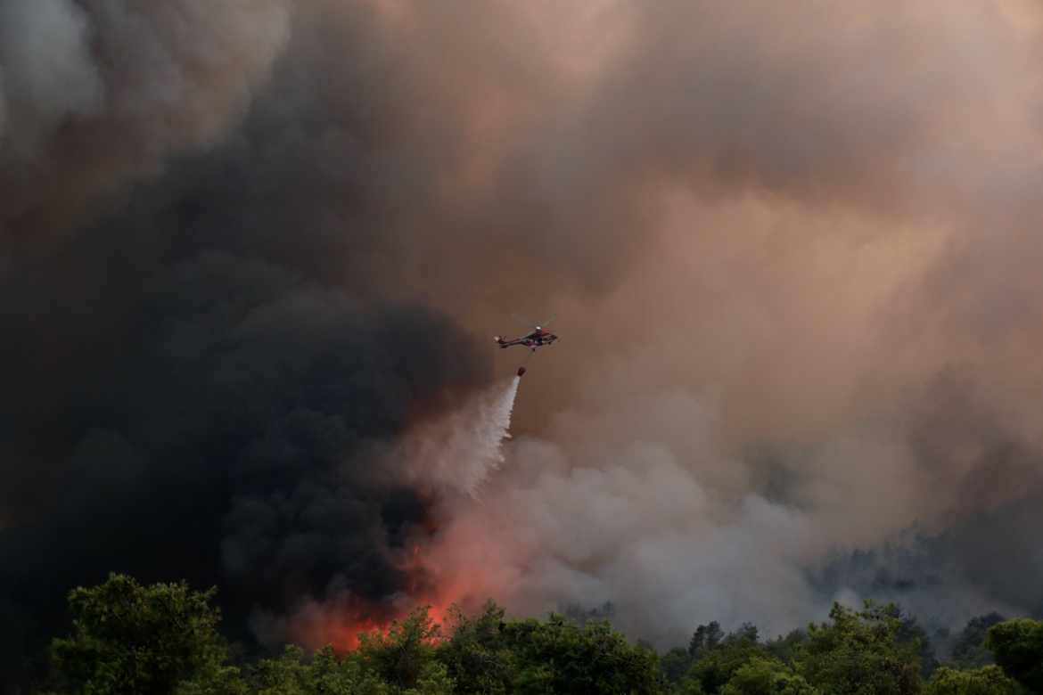Greece has been hit by a spate of wildfires fanned by strong winds and high temperatures. [Yorgos Karahalis/AP Photo]