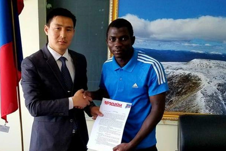 Moshood Afolabi, 24, signed a contract, drafted in Mongolian Cyrillic with Khovd Western FC, but his career came to an abrupt end as his agent disappeared [Courtesy of Moshood Afolabi]