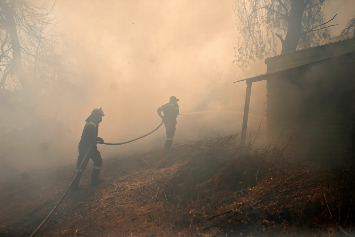 More than 1,000 firefighters are assigned to the blazes across Greece. [Kostas Tsironis/EPA]