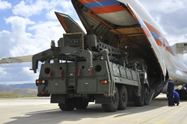 Military vehicles and equipment, parts of the S-400 air defence systems, are unloaded from a Russian transport aircraft, at Murted airport in Ankara on July 12, 2019 ]Turkish Defence Ministry via AP]