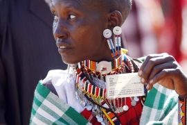 A Maasai woman holds her ID card as she waits to cast her ballot in a polling station near the town of Magadi in Kenya on March 4, 2013 [File: Goran Tomasevic/Reuters]