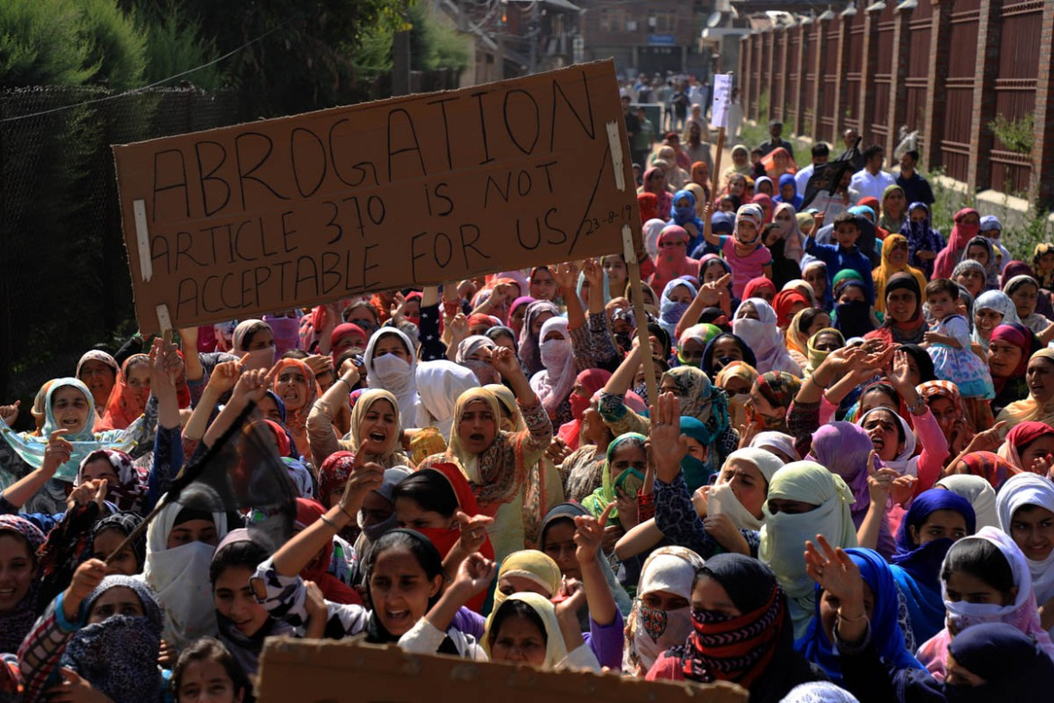 Kashmiri women holding placards shout pro-freedom slogans as they take part in a protest march after Friday prayers in Soura area of Srinagar on August 23. [Syed Shahriyar/Al Jazeera]