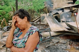 A Colombian woman cries in front her house, which was destroyed during a guerrilla attack in the village of La Caucana, Antioquia province [File: Reuters]