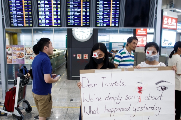 Travel demand to Hong Kong has weakened as anti-government protests stretch into their sixth month, leading major airlines to temporarily cut capacity [File: Thomas Peter/Reuters]
