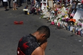A man prays at a memorial three days after a mass shooting at a Walmart store in El Paso, Texas, US August 6, 2019 [Callaghan O'Hare/Reuters]