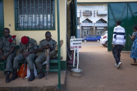 Cameroonian soldiers sit at the entrance to a polling station in the capital Yaounde [File: Nic Bothma/EPA]