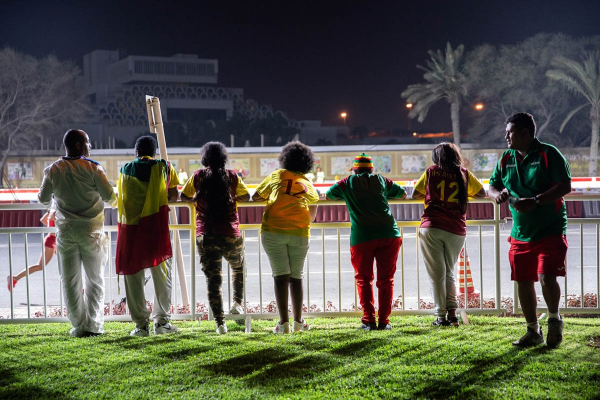 'This is the one chance we'll get to cheer on athletes from our country. No way we are going home before it's finished,' said a group of Ethiopian supporters who stayed back despite having an early start the next morning. [Faras Ghani/Al Jazeera]