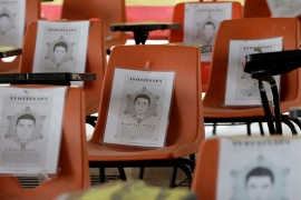 Chairs with pictures of the missing students from Ayotzinapa Teachers Training College are seen at the college before the fifth anniversary of the disappearance of 43 students [Luis Cortes/Reuters]