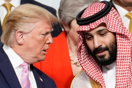 US President Donald Trump with Saudi Arabia's Mohammed bin Salman at the G20 leaders' summit in Japan, in June 2019 [File: Reuters]