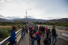 Migrants crossed Simon Bolivar International Bridge, the main gateway between Colombia and Venezuela. [Megan Janetsky/Al Jazeera]