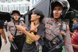 Police officers arrest a student demonstrator during a protest in Medan, North Sumatra on Tuesday [Anadolu]