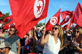 Supporters of Tunisia's former defence minister and presidential candidate Abdelkrim Zbidi during his presidential electoral campaign in Monastir [Mohamed Messara/EPA]