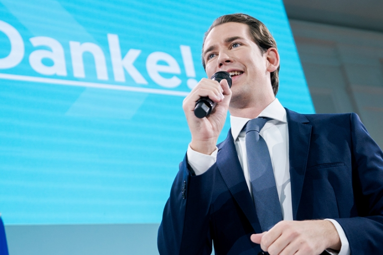Sebastian Kurz gives a speech after the first exit polls in Vienna on Sunday [Georg Hockmuth/AFP]