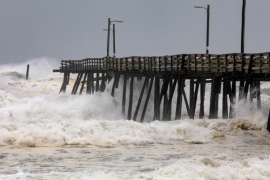Waves caused by Hurricane Dorian damage Nags Head Pier in North Carolina [Jim Lo Scalzo/EPA]
