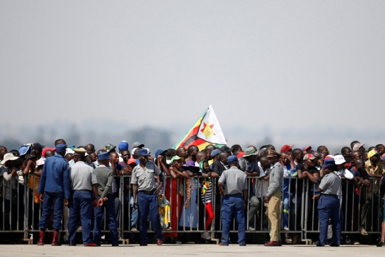 Hundreds of Mugabe's supporters waited for the arrival of the body of the former Zimbabwean president [Siphiwe Sibeko/Reuters]