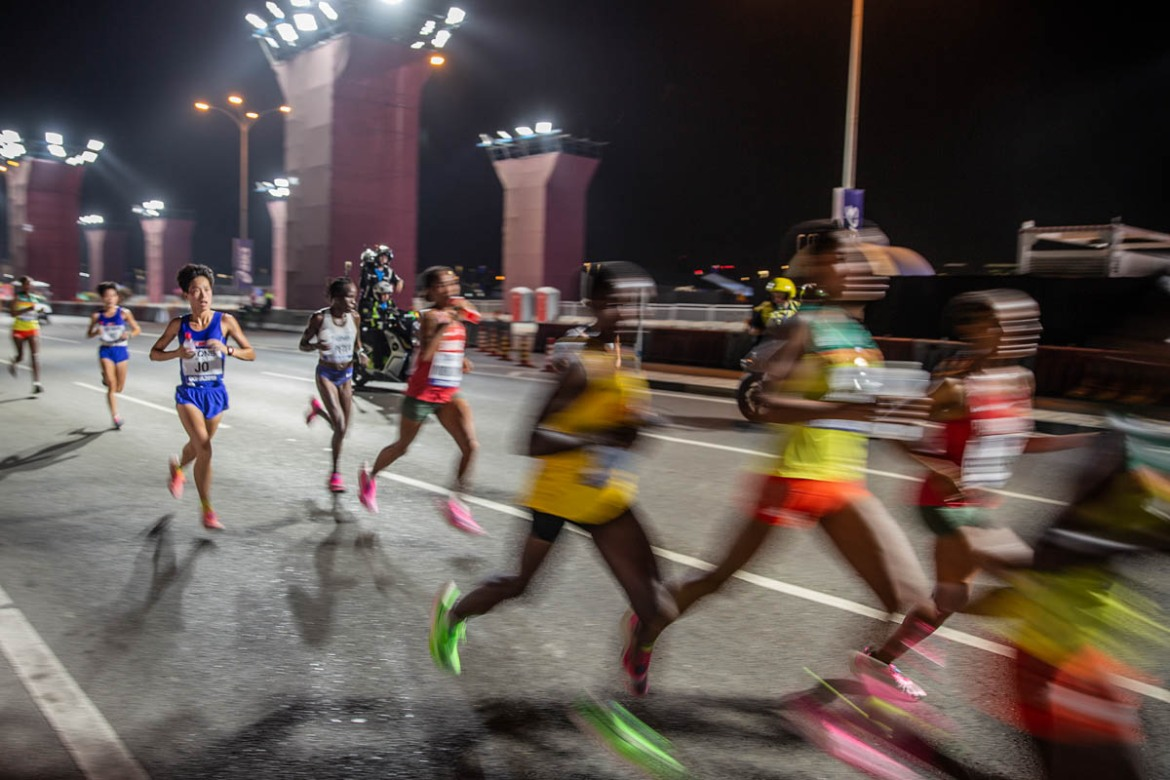 Sixty-eight runners took part in the midnight marathon, the first time it was staged at this time of the night. [Faras Ghani/Al Jazeera]