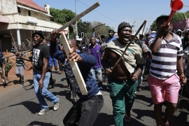 Residents of local hostels march with homemade weapons against migrants in Johannesburg, South Africa, September 8, 2019 [AP]
