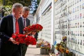 John Bolton and US Embassy Charge d'Affairs William Taylor lay wreaths at Kiev's memorial for soldiers killed in eastern Ukraine [Gleb Garanich/Reuters]