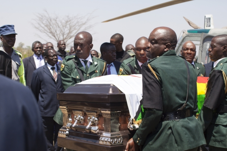 Members of the presidential guard transfer the coffin of Mugabe to his village earlier this month [Wilfred Kajese/Anadolu Agency]