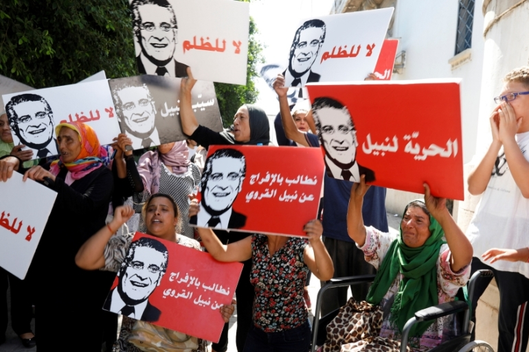 Supporters of presidential candidate Nabil Karoui take part in a rally in front of the courthouse asking for his release from prison in Tunis, Tunisia, September 3, 2019 [Zoubeir Souissi/Reuters]