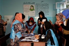 Low turnout, technical glitches mark Afghan presidential election