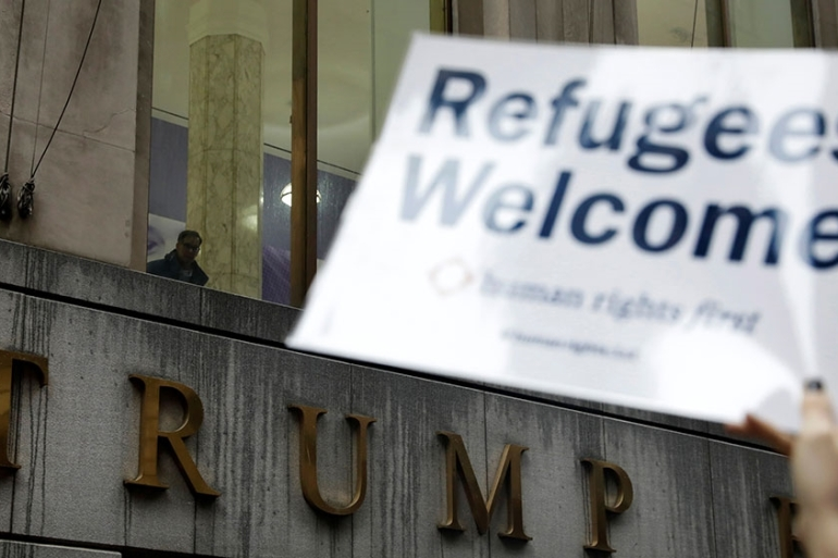 Protesters gather outside the Trump Building at 40 Wall Street to take action against the United States' refugee ban in New York, March 28, 2017 [File: Lucas Jackson/Reuters]