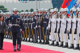 Taiwan's Tsai reviews the honour guard at a ceremony welcoming Guatemalan President Jimmy Morales last April [File: Tyrone Siu/Reuters]