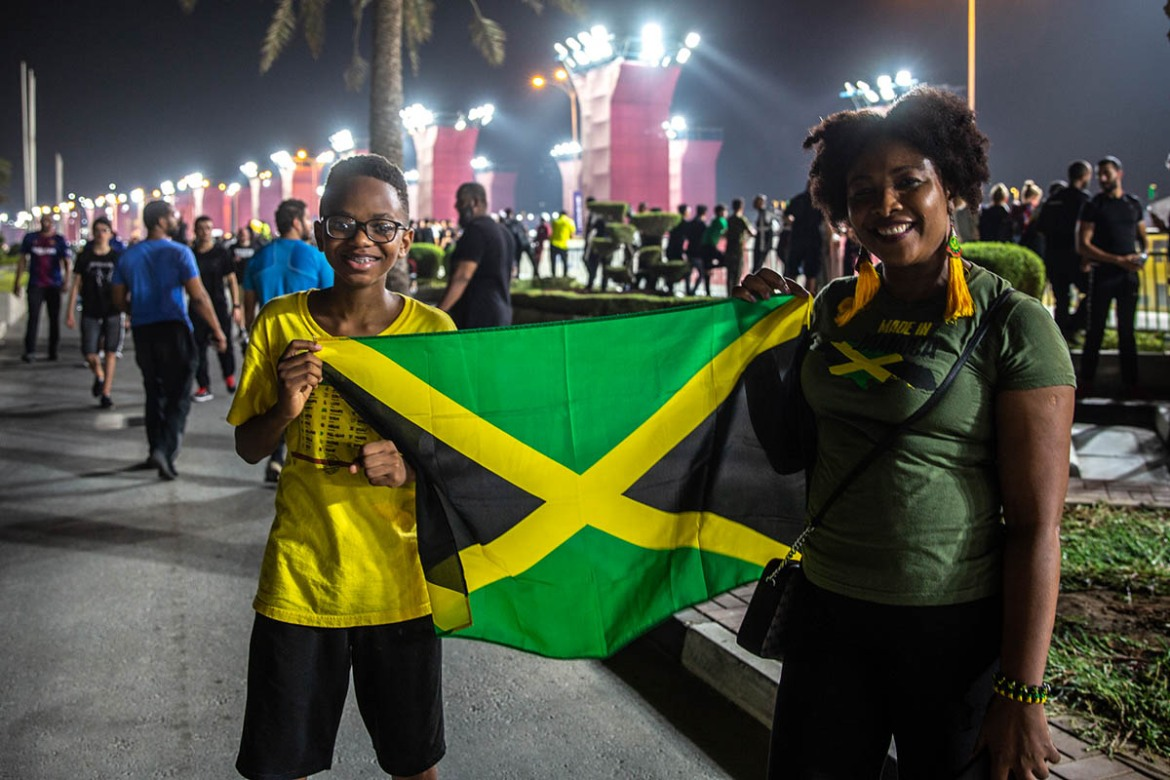 Despite superstar sprinter Usain Bolt's absence, the Jamaican fans were confident their track teams will go back with a few medals. 'Bolt has already done a lot for Jamaica. It's time the youngsters shine and I'm confident they will do that,' said a Jamaican supporter. [Faras Ghani/Al Jazeera]