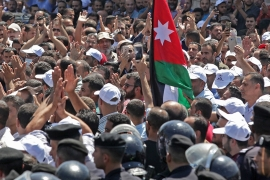 Jordanian teachers chant slogans and wave the national flag during a protest in the capital, Amman, on Saturday [File: Khalil Mazraawi/AFP]