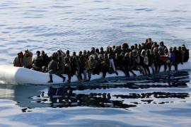 Migrants are seen in a rubber dinghy in the Mediterranean Sea off the coast of Libya, January 15, 2018 [Hani Amara/Reuters]