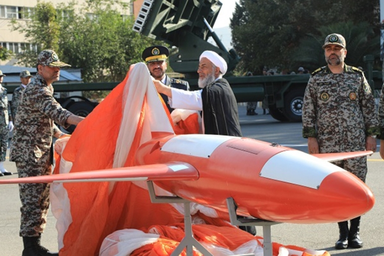 Brigadier-General Alireza Sabahifard, centre, unveils the drone during a ceremony in the capital Tehran [Iranian Army office via AFP]