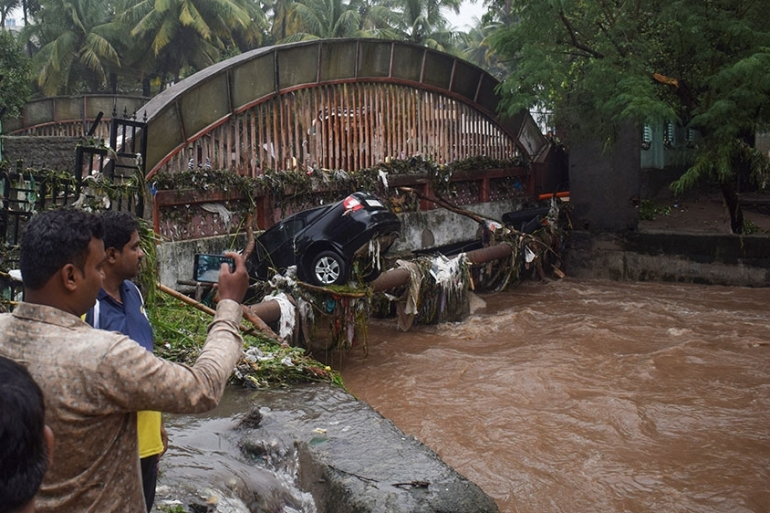 The floods swept away cars and caused buildings to collapse in Pune city [File: AFP]