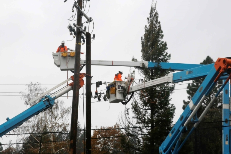 PG&E crew work on power lines to repair damage caused by the Camp Fire in Paradise, California, US November 21, 2018. [File Elijah Nouvelage/Reuters]