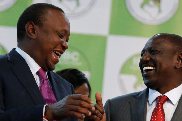 President Uhuru Kenyatta celebrates with Deputy President William Ruto after winning the presidential election  in Nairobi, Kenya on August 11, 2017 [File:Thomas Mukoya/Reuters]