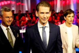 Sebastian Kurz, centre, of the People's Party is predicted to win Sunday's vote [Leonhard Foeger/Reuters]
