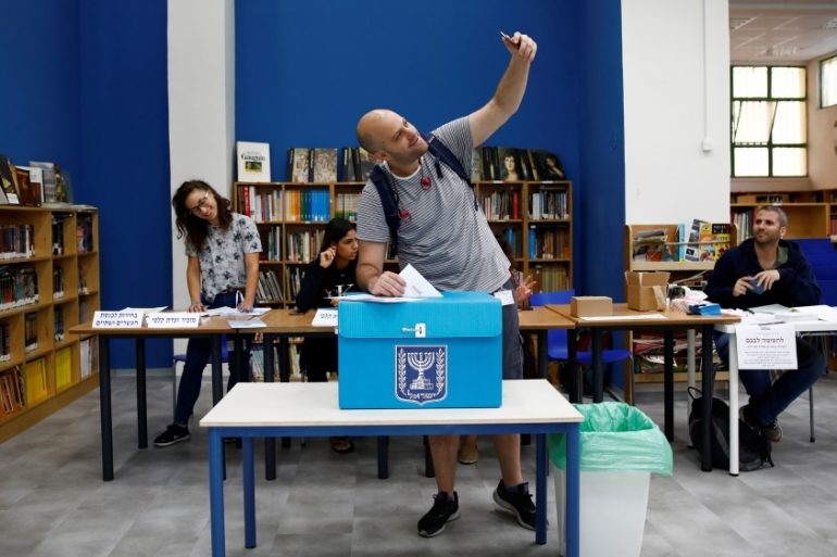 Voting closed at 10pm local time at 11,163 polling stations, with 31 parties competing for the 120 seats. [Corinna Kern/Reuters]