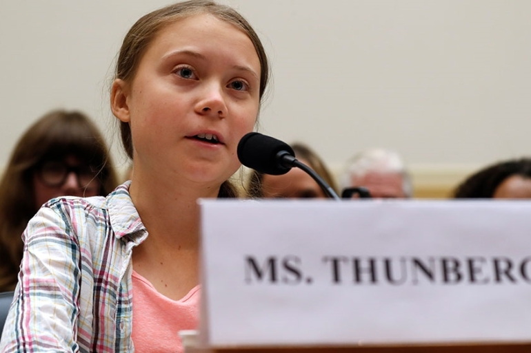 Youth climate change activist Greta Thunberg, (left), speaks at a House Foreign Affairs Committee subcommittee hearing on climate change [Jacquelyn Martin/AP Photo]
