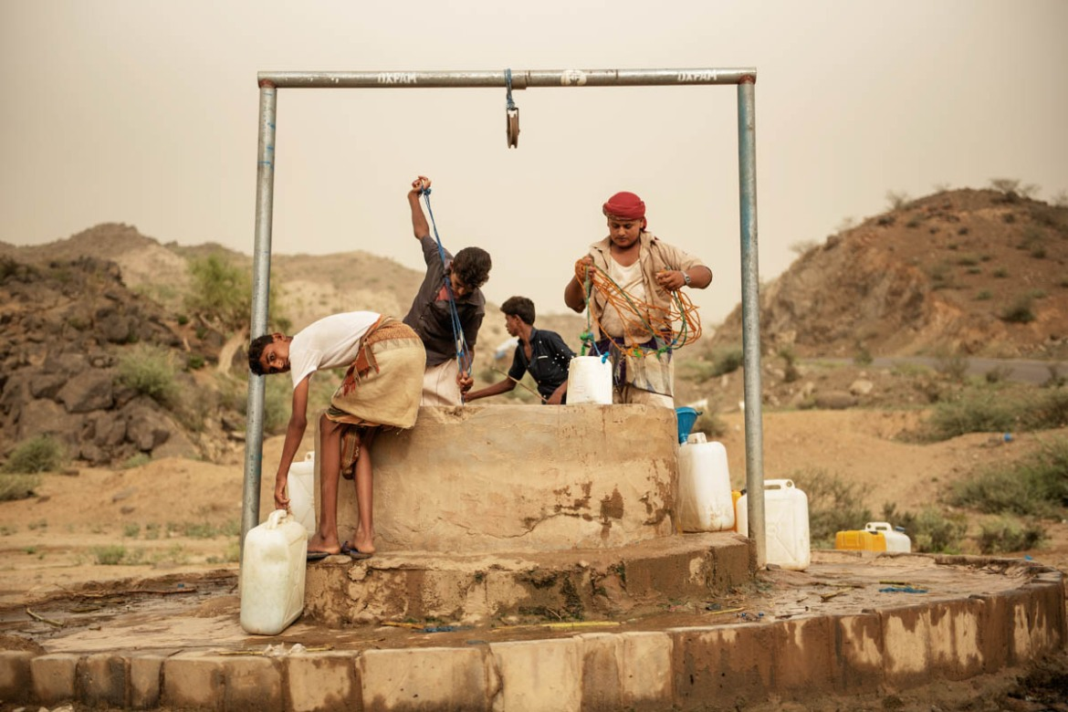 Boys drawing water from a well in Aslam in the Abs region. Humanitarian groups stress that water from the wells is not fit for human consumption as it could cause cholera. [Alessio Romenzi/Al Jazeera]