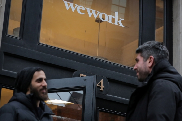 Having aborted plans for an initial public offering, WeWork 'does not have sufficient funding to meet its growth plan', Fitch Ratings said [File: Brendan McDermid/Reuters]