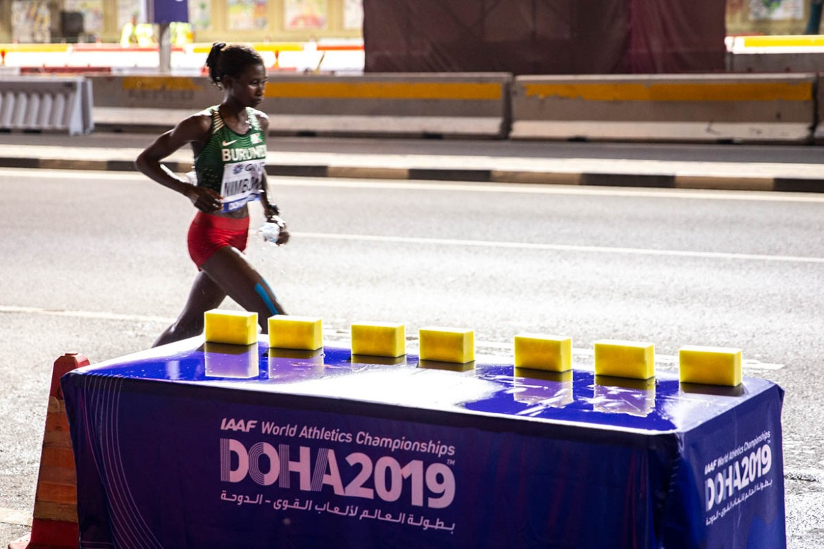 At the water stations for the marathon runners, sponges dipped in ice-cold water were available for athletes to cool themselves down with. [Faras Ghani/Al Jazeera]