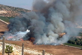 Smoke rises from Israeli army shells that landed in the southern Lebanese border village of Maroun al-Ras in Lebanon [File: The Associated Press]