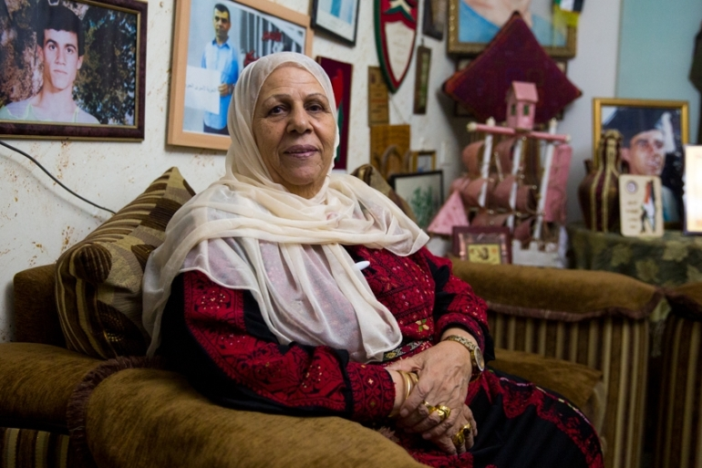 Malka Abu Aker, a Palestinian living in the Dheisheh refugee camp near Bethlehem, has seen her son - and now her grandson - join the 40 percent of male Palestinians in the occupied territories who have served time in Israeli prisons [Erik Paul Howard]