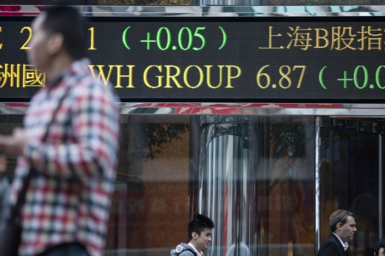 Shares in Asia followed their Wall Street counterparts into positive territory on Wednesday after US President Donald Trump said Iran appeared to be 'standing down' [File: Justin Chin/Bloomberg]