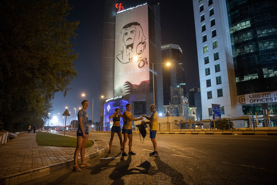 Due to the daytime heat in Doha, athletes taking part in the World Championships opt to train late into the night. This group of athletes from Ukraine pulled up midway through their training session after 10pm local time (19:00 GMT). 'Getting used to this [heat, humidity] is very difficult. We have never experienced this before,' said one of the athletes. [Faras Ghani/Al Jazeera]