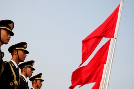 Soldiers stand at attention before a wreath laying ceremony at the Monument to the People''s Heroes in Tiananmen Square, marking the 70th anniversary of the founding of the People''s Republic of China. [Thomas Peter/Reuters]