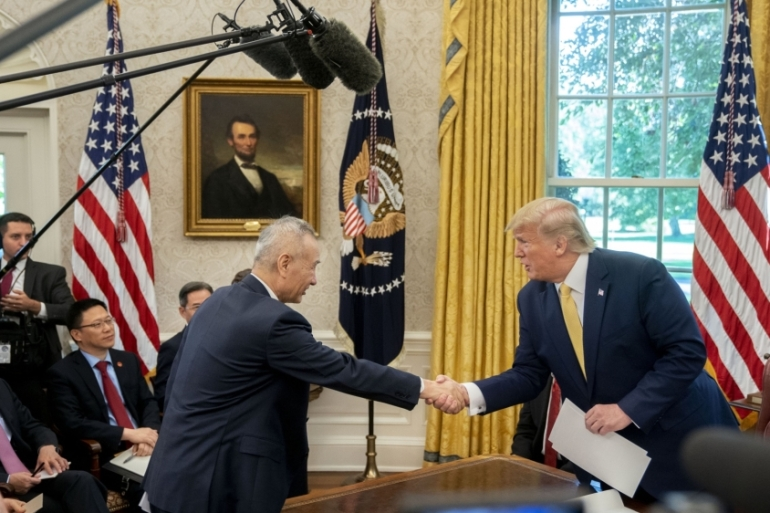 US President Donald Trump, (right), shook hands with Chinese Vice Premier Liu He in Washington, DC on Friday after two days of trade negotiations [File: Andrew Harrer/Bloomberg]