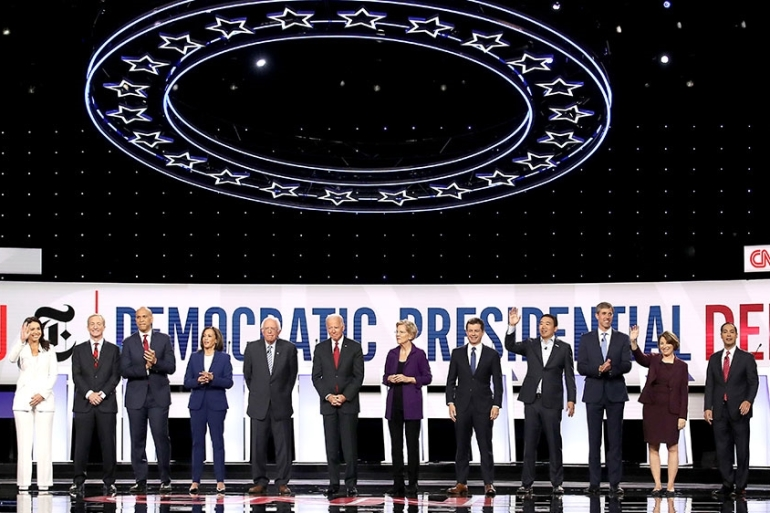Twelve Democratic presidential hopefuls take the stage at the October debate in Ohio [Win McNamee/Getty Images/AFP]