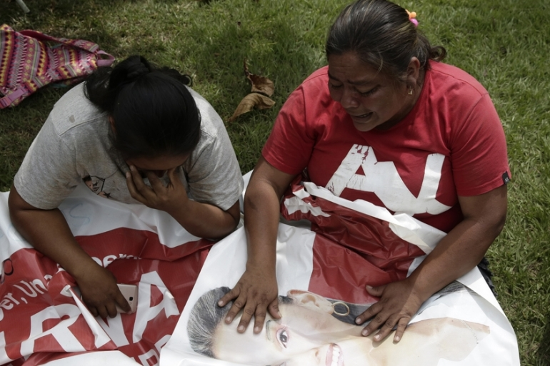 Friends and family of liberal politician Karina Garcia who was killed along with five others, crying in Suarez, Cauca, Colombia [Ernesto Guzman Jr/EPA-EFE]