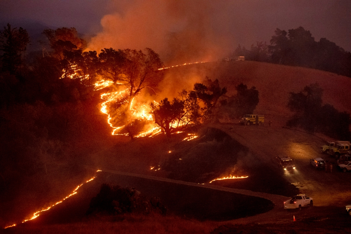 The blaze forced evacuation orders and warnings for nearly all of Sonoma County stretching to the coast. [Noah Berger/AP Photo]