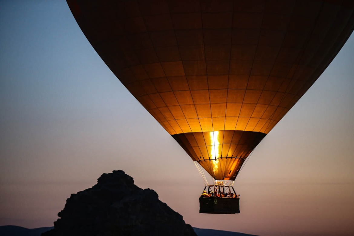 In Cappadocia, early-morning hot air balloon trips are very popular among local and international tourists. [Emrah Gurel/AP Photo]